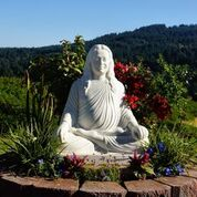 Yogananda-statue-in-flowers-1